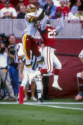 8 Nov 1998: Wide receiver Albert Connell #83 of the Washington Redskins in action against cornerback J. B. Brown #26 of the Arizona Cardinals during the game at the Sun Devil Stadium in Tempe, Arizona. The Cardinals defeated the Redskins 29-27.