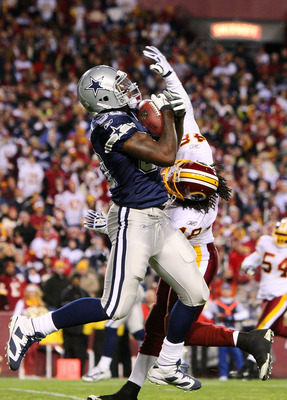 LANDOVER, MD - NOVEMBER 16:  Martellus Bennett #80 of the Dallas Cowboys catches a touchdown pass against Chris Horton #48 of the Washington Redskins to lead Dallas 14-10 over Washington in the fourth quarter during the game on November 16, 2008 at FedEx