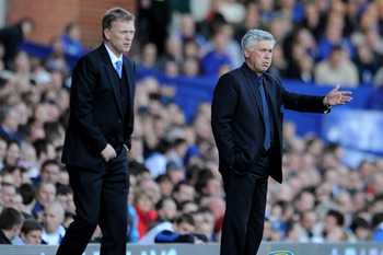LIVERPOOL, ENGLAND - MAY 22:  Chelsea Manager Carlo Ancelotti (R) gestures during the Barclays Premier League match between Everton and Chelsea at Goodison Park on May 22, 2011 in Liverpool, England.  (Photo by Chris Brunskill/Getty Images)