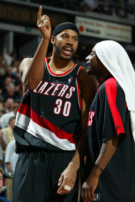 SACRAMENTO, CA -  JANUARY 20:   Rasheed Wallace #30 of the Portland Trail Blazers argues after receiving a technical foul as he is held back by teammate Jeff McInnis #5 against the Sacramento Kings during an NBA game on January 20, 2004 at Arco Arena in S