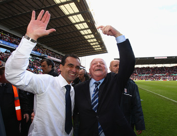 STOKE ON TRENT, ENGLAND - MAY 22:  Dave Whelan, Chairman of Wigan Athletic and manager Roberto Martinez celebrate after winning 1-0 to keep them in the Premiere League during the Barclays Premier League match between Stoke City and Wigan Athletic at Brita