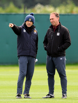 MANCHESTER, ENGLAND - MAY 12:  Manchester City manager Roberto Mancini (L) makes a point to his assistant David Platt during a training session at Carrington Training Ground on May 12, 2011 in Manchester, England.  (Photo by Chris Brunskill/Getty Images)
