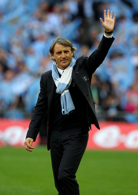 LONDON, ENGLAND - MAY 14:  Roberto Mancini salutes the fans after his Manchester City team won the FA Cup sponsored by E.ON Final match between Manchester City and Stoke City at Wembley Stadium on May 14, 2011 in London, England.  (Photo by Alex Livesey/G