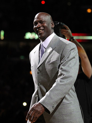 CHICAGO, IL - MARCH 12: Former player Michael Jordan of the Chicago Bulls smiles as he is introduced to  the crowd during a 20th anniversary recognition ceremony of the Bulls 1st NBA Championship in 1991 during half-time of a game bewteen the Bulls and th