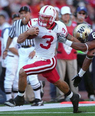 SEATTLE - SEPTEMBER 18:  Quarterback Taylor Martinez #3 of the Nebraska Cornhuskers rushes against Nate Williams #8 of the Washington Huskies on September 18, 2010 at Husky Stadium in Seattle, Washington. The Cornhuskers defeated the Huskies 56-21. (Photo