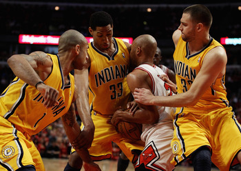 CHICAGO, IL - APRIL 26: Taj Gibson #22 of the Chicago Bulls battles for the ball with (L-R) Dahntay Jones #1, Danny Granger #33 and Josh McRoberts #32 of the Indiana Pacers in Game Five of the Eastern Conference Quarterfinals in the 2011 NBA Playoffs at t
