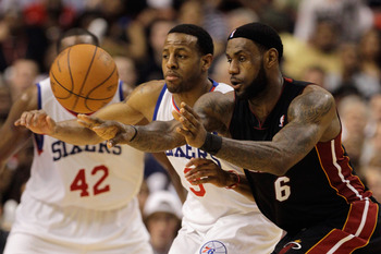 PHILADELPHIA, PA - APRIL 24:  LeBron James #6 of the Miami Heat passes the ball in front of Andre Iguodala #9 of the Philadelphia 76ers during the second half in Game Four of the Eastern Conference Quarterfinals in the 2011 NBA Playoffs at Wells Fargo Cen