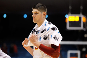 DAYTON, OH - MARCH 16: Nikola Vucevic #5 of the USC Trojans walks off the court after being defeated by the Virginia Commonwealth Rams during the first round of the 2011 NCAA men's basketball tournament at UD Arena on March 16, 2011 in Dayton, Ohio.  (Pho