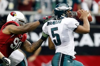GLENDALE, AZ - JANUARY 18:  Quarterback Donovan McNabb #5 of the Philadelphia Eagles looks to avoid a sack from defensive end Darnell Dockett #90 of the Arizona Cardnals during the NFC championship game on January 18, 2009 at University of Phoenix Stadium