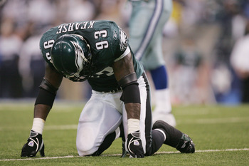 IRVING, TX - NOVEMBER 15:  Defensive end Jevon Kearse #93 of the Philadelphia Eagles kneels on the turf while facing the Dallas Cowboys on November 15, 2004 at Texas Stadium in Irving, Texas.   The Eagles defeated the Cowboys 49-21.  (Photo by Ronald Mart