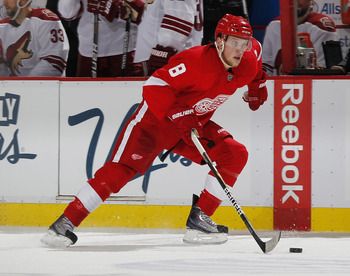 DETROIT, MI - APRIL 16: Justin Abdelkader #8 of the Detroit Red Wings skates with the puck while playing the Phoenix Coyotes in Game Two of the Western Conference Quarterfinals during the 2011 Stanley Cup Playoffs at Joe Louis Arena on April 16, 2011 in D