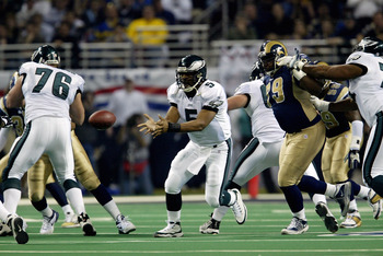 27 Jan 2002: Quarteback Donovan McNabb of the Philadelphia Eagles receives a pass during the NFC Championship Game against the St.Louis Rams at the Dome at  America's Center in St.Louis, Missouri. The Rams advance to the Superbowl after winning 29-24. DIG