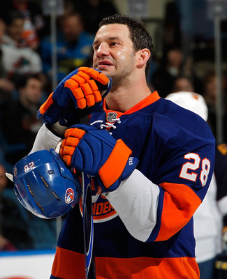 UNIONDALE, NY - MARCH 24:  Zenon Konopka #28 of the New York Islanders stands for the National Anthem before an NHL hockey game against the Atlanta Thrashers at the Nassau Coliseum on March 24, 2011 in Uniondale, New York.  (Photo by Paul Bereswill/Getty