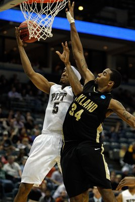 MILWAUKEE - MARCH 19:  Gilbert Brown #5 of the Pittsburgh Panthers goes up for a shot against Keith Benson #34 of the Oakland Golden Grizzlies during the first round of the 2010 NCAA men's basketball tournament at the Bradley Center on March 19, 2010 in M