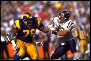 13 OCT 1991:  LOS ANGELES RAMS OFFENSIVE LINEMAN JACKIE SLATER #78 BATTLES WITH SAN DIEGO CHARGERS DEFENSIVE LINEMAN BURT GROSSMAN #92 DURING THE RAMS 30-24 WIN AT ANAHEIM STADIUM IN ANAHEIM, CALIFORNIA.