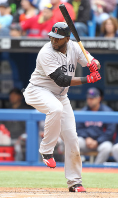 TORONTO, CANADA - JUNE 11:  David Ortiz #34 of the Boston Red Sox bats against the Toronto Blue Jays in a MLB game on June 11, 2011 at the Rogers Centre in Toronto, Ontario, Canada.  (Photo by Claus Andersen/Getty Images)