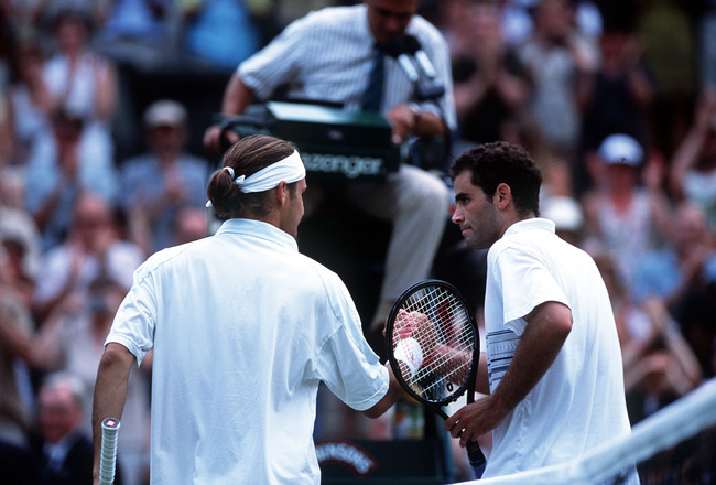 2 Jul 2001:  Pete Sampras of the USA congratulates Roger Federer of Switzerland following his victory during the men's fourth round of The All England Lawn Tennis Championship at Wimbledon, London.  Mandatory Credit: Clive Brunskill/ALLSPORT