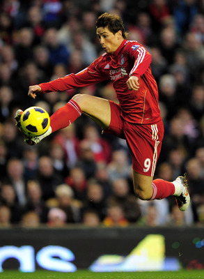LIVERPOOL, ENGLAND - NOVEMBER 07:   Fernando Torres of Liverpool wins the ball during the Barclays Premier League match between Liverpool and Chelsea at Anfield on November 7, 2010 in Liverpool, England. (Photo by Shaun Botterill/Getty Images)