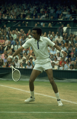 JUN 1975:  ARTHUR ASHE OF THE UNITED STATES HITS A BACKHAND ON THE CENTRE COURT AT WIMBLEDON DURING THE MENS SINGLES.