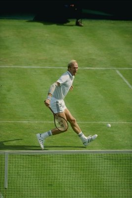 1980:  Stan Smith in action during a match at Wimbledon in London, England. Mandatory Credit: Tony Duffy  /Allsport