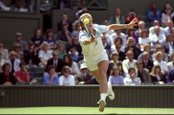 Jun-Jul 1990:  Stefan Edberg of Sweden reaches to play a forehand return during the Lawn Tennis Championships at Wimbledon in London. \ Mandatory Credit: Russell  Cheyne/Allsport