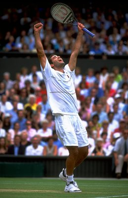 4 Jul 1999:  Pete Sampras of the United States celebrates victory after winning the Men's Singles Championship Final match against Andre Agassi also of the United States played at the All England Club in Wimbledon, England.  The match finished in a compre