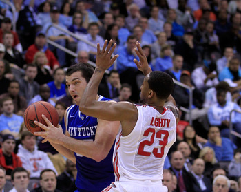 NEWARK, NJ - MARCH 25:  Josh Harrellson #55 of the Kentucky Wildcats in action against David Lighty #23 of the Ohio State Buckeyes during the east regional semifinal of the 2011 NCAA Men's Basketball Tournament at the Prudential Center on March 25, 2011 i