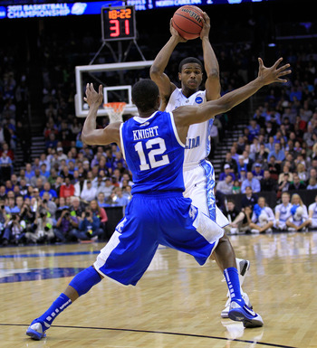 NEWARK, NJ - MARCH 27:  Brandon Knight #12 of the Kentucky Wildcats blocks Dexter Strickland #1 of the North Carolina Tar Heels during the east regional final of the 2011 NCAA men's basketball tournament at Prudential Center on March 27, 2011 in Newark, N