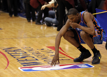 DALLAS, TX - MAY 25:  Kevin Durant #35 of the Oklahoma City Thunder reacts after the Thunder were defeated by the Dallas Mavericks 100-96 in Game Five of the Western Conference Finals during the 2011 NBA Playoffs at American Airlines Center on May 25, 201