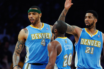 LOS ANGELES, CA - APRIL 03:  Kenyon Martin #4 of the Denver Nuggets celebrates with teammates Raymond Felton #20 and Wilson Chandler #21 after scoring a basket against the Los Angeles Lakers during the NBA basketball game at Staples Center on April 3, 201