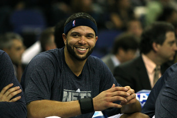 LONDON, ENGLAND - MARCH 04:  #8 Deron Williams of the Netslooks on from the bench during the NBA match between New Jersey Nets and the Toronto Raptors at the O2 Arena on March 4, 2011 in London, England. NOTE TO USER: User expressly acknowledges and agree