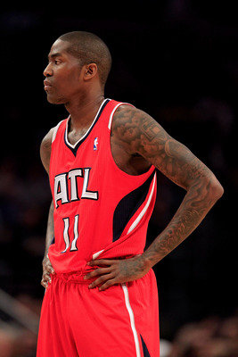 NEW YORK, NY - FEBRUARY 16:  Jamal Crawford #11 of the Atlanta Hawks looks on against the New York Knicks at Madison Square Garden on February 16, 2011 in New York City. NOTE TO USER: User expressly acknowledges and agrees that, by downloading and/or usin