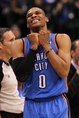 DALLAS, TX - MAY 25:  Russell Westbrook #0 of the Oklahoma City Thunder reacts in the fourth quarter while taking on the Dallas Mavericks in Game Five of the Western Conference Finals during the 2011 NBA Playoffs at American Airlines Center on May 25, 201
