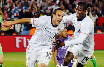 PRETORIA, SOUTH AFRICA - JUNE 23:  Landon Donovan of the United States celebrates with teammate Edson Buddle after scoring the winning goal that sends the USA through to the second round during the 2010 FIFA World Cup South Africa Group C match between US