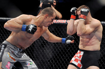 DALLAS - SEPTEMBER 19:  UFC fighter Junior Dos Santos (L) battles UFC fighter Mirko Cro Cop (R) during their Heavyweight bout at UFC 103: Franklin vs. Belfort at the American Airlines Center on September 19, 2009 in Dallas, Texas.  (Photo by Jon Kopaloff/