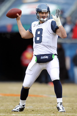 CHICAGO, IL - JANUARY 16:  Quarterback Matt Hasselbeck #8 of the Seattle Seahawks looks to throw the ball during pregame before taking on the Chicago Bears in the 2011 NFC divisional playoff game at Soldier Field on January 16, 2011 in Chicago, Illinois.