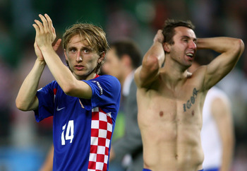 VIENNA, AUSTRIA - JUNE 20:  Darijo Srna of Croatia holds his head as Luka Modric acknowledges the fans after defeat in the UEFA EURO 2008 Quarter Final match between Croatia and Turkey at Ernst Happel Stadion on June 20, 2008 in Vienna, Austria.  (Photo b