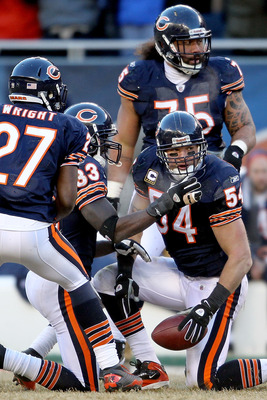 CHICAGO, IL - JANUARY 23:  Linebacker Brian Urlacher #54 of the Chicago Bears reacts with teammates after his 39-yard interception return against the Green Bay Packers in the NFC Championship Game at Soldier Field on January 23, 2011 in Chicago, Illinois.