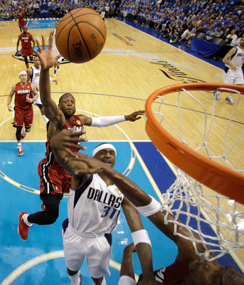 DALLAS, TX - JUNE 05:  Dwyane Wade #3 of the Miami Heat blocks a shot attempt by Jason Terry #31 of the Dallas Mavericks in Game Three of the 2011 NBA Finals at American Airlines Center on June 5, 2011 in Dallas, Texas.  NOTE TO USER: User expressly ackno