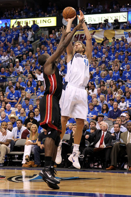 DALLAS, TX - JUNE 09:  Dirk Nowitzki #41 of the Dallas Mavericks attempts a shot against Joel Anthony #50 of the Miami Heat in Game Five of the 2011 NBA Finals at American Airlines Center on June 9, 2011 in Dallas, Texas.  NOTE TO USER: User expressly ack