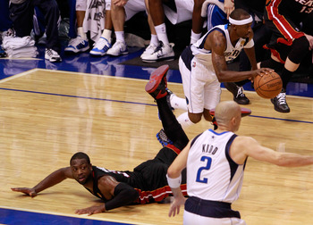 DALLAS, TX - JUNE 09:  Jason Terry #31 of the Dallas Mavericks pushes the ball up court past Dwyane Wade #3 of the Miami Heat in the fourth quarter of Game Five of the 2011 NBA Finals at American Airlines Center on June 9, 2011 in Dallas, Texas.  NOTE TO