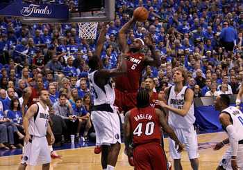 DALLAS, TX - JUNE 05:  LeBron James #6 of the Miami Heat attempts a dunk in the first half against Ian Mahinmi #28 of the Dallas Mavericks in Game Three of the 2011 NBA Finals at American Airlines Center on June 5, 2011 in Dallas, Texas.  NOTE TO USER: Us