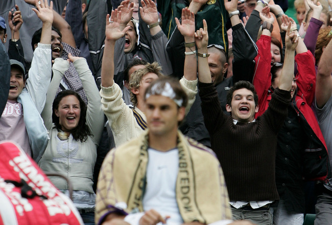 LONDON - JUNE 25:  The crowd do a Mexican Wave during the match between Roger Federer of Switzerland and Nicolas Kiefer of Germany during the sixth day of the Wimbledon Lawn Tennis Championship on June 25, 2005 at the All England Lawn Tennis and Croquet C