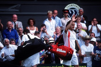 2 Jul 2001:  Roger Federer (right) of Switzerland salutes the fans as Pete Sampras of the USA walks off court during the men's fourth round of The All England Lawn Tennis Championship at Wimbledon, London.  DIGITAL IMAGE Mandatory Credit: Clive Brunskill/