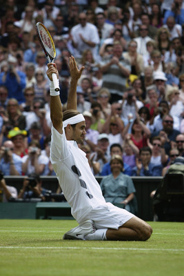 LONDON - JULY 6:  Roger Federer of Switzerland celebrates after his victory over Mark Philippoussis of Australia in the Men's Singles Final during the final day of the Wimbledon Lawn Tennis Championships held on July 6, 2003 at the All England Lawn Tennis