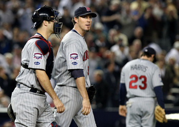 NEW YORK - OCTOBER 09:  Joe Mauer #7 talks with Joe Nathan #36 of the Minnesota Twins after an erron in the tenth inning against the New York Yankees in Game Two of the ALDS during the 2009 MLB Playoffs at Yankee Stadium on October 9, 2009 in the Bronx bo