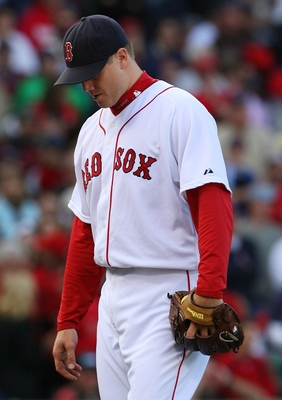 BOSTON - OCTOBER 11:  Pitcher Jonathan Papelbon #58 of the Boston Red Sox reacts after allowing three runs in the ninth inning to blow the save against the Los Angeles Angels of Anaheim in Game Three of the ALDS during the 2009 MLB Playoffs at Fenway Park