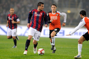 BOLOGNA, ITALY - OCTOBER 28: Pablo Daniel Osvaldo of Bologna FC competes with Albin Ekdal of AC Siena during the match of Serie A between Bologna FC and AC Siena at Stadio Renato Dall'Ara on October 28, 2009 in Bologna, Italy.  (Photo by Roberto Serra/Get