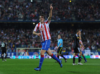 MADRID, SPAIN - OCTOBER 21:  Diego Godin of Atletico Madrid celebrates scoring his sides opening goal during the UEFA Europa League group B match between Atletico Madrid and Rosenborg at the Vicente Calderon Stadium on October 21, 2010 in Madrid, Spain.