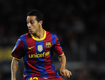 BARCELONA, SPAIN - DECEMBER 07:  Thiago Alcantara of Barcelona runs with the ball during the Champions League match between Barcelona and Rubin Kazan at Camp Nou Stadium on December 7, 2010 in Barcelona, Spain. Barcelona won 2-0.  (Photo by David Ramos/Ge